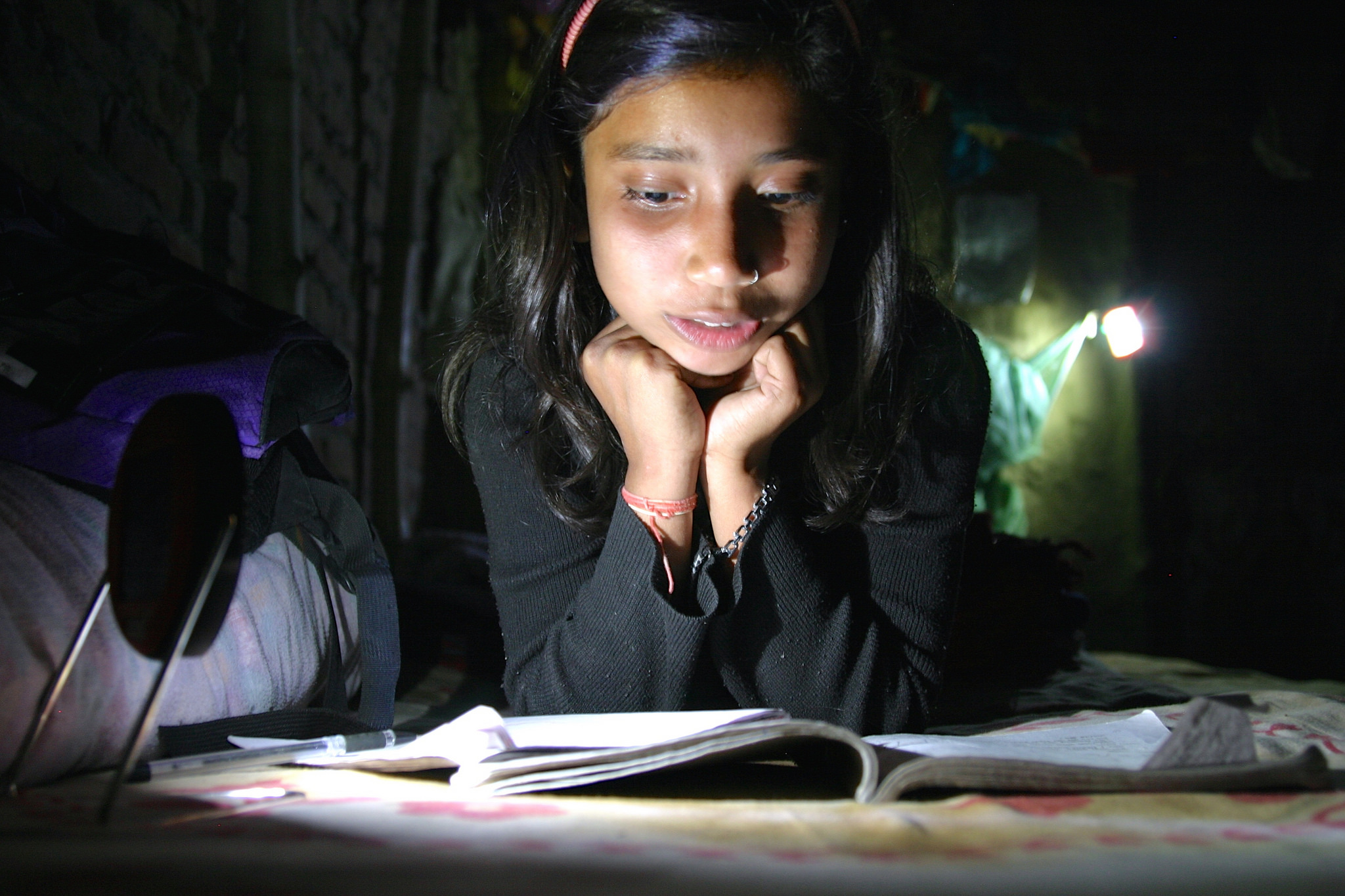 Priya is one of Runa Jha's three children and she loves to study more with solar light and wants to become a scientist!