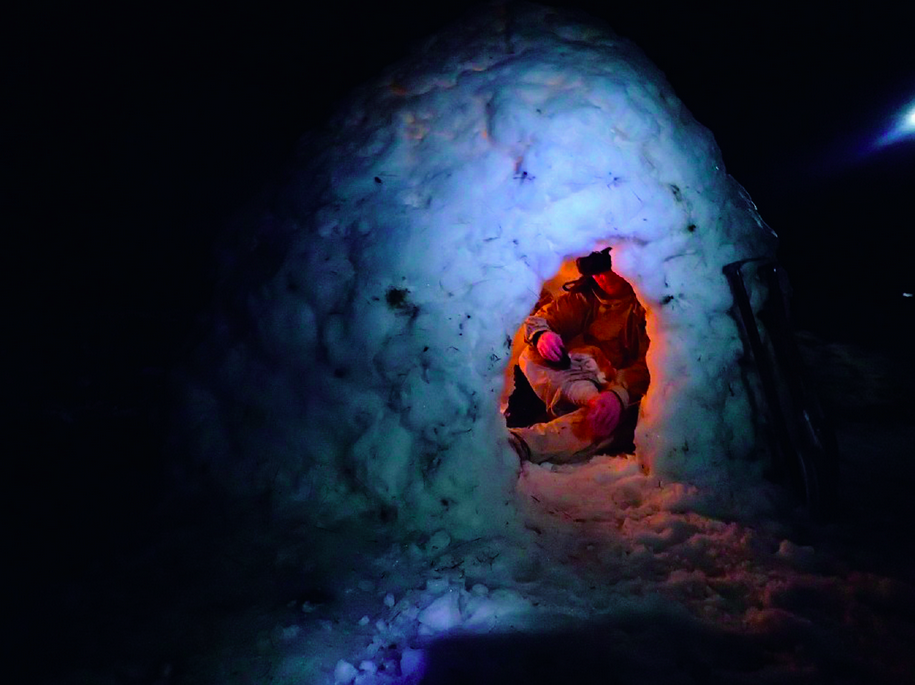 Baz settling in for the night in an igloo.