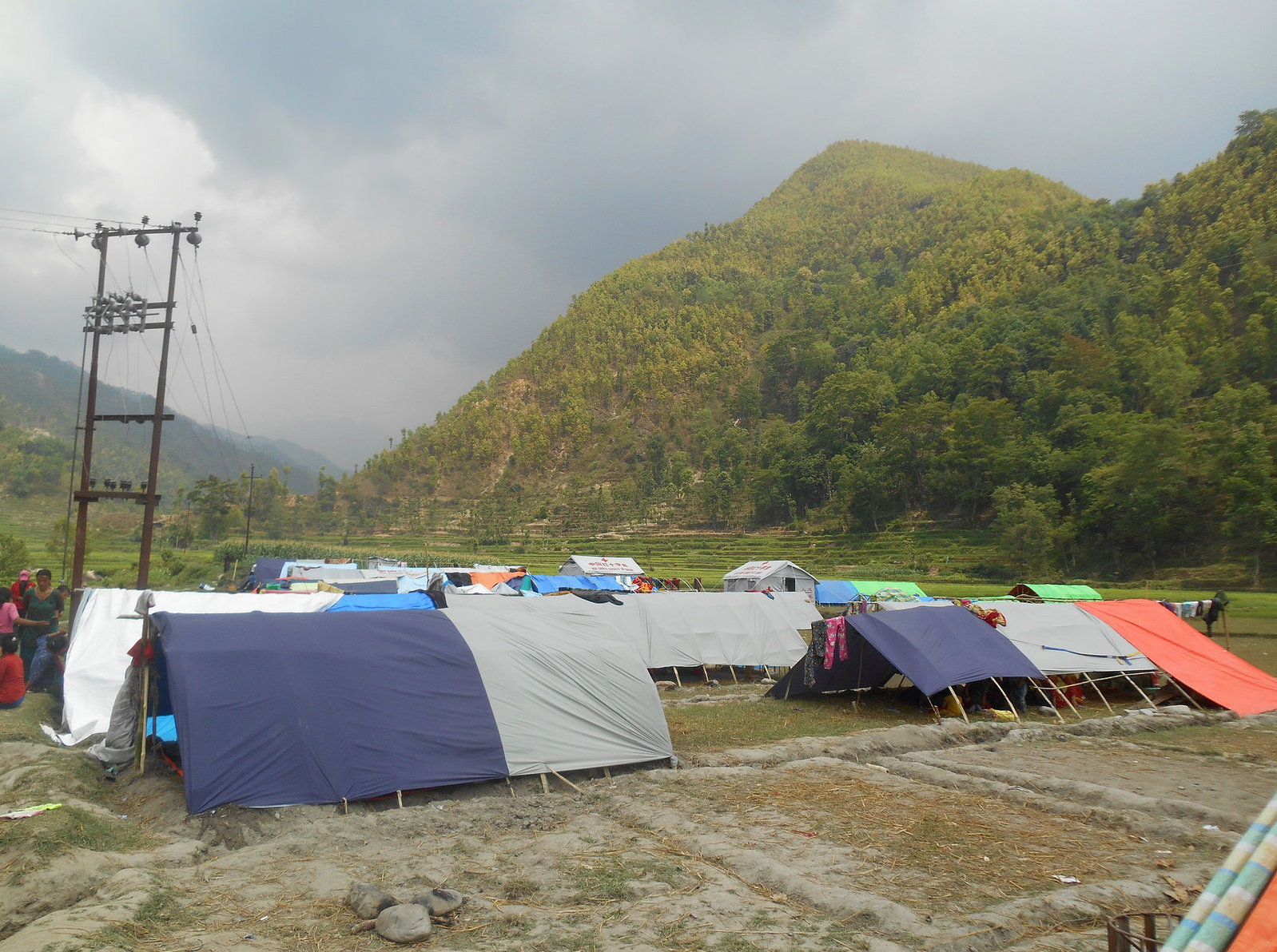 Tents are erected along a river in Nuwakot to provide shelter for those whose homes were destroyed.
