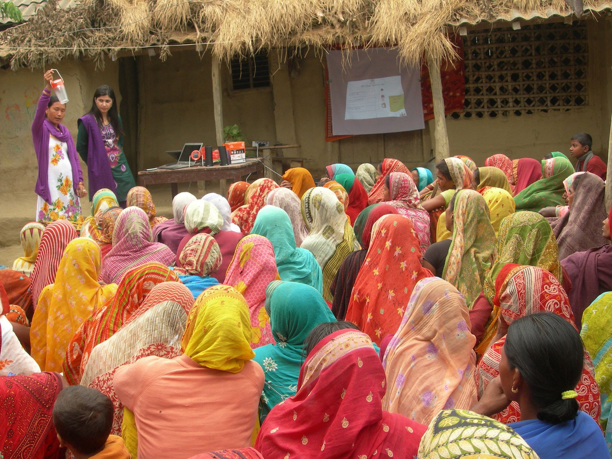 Empower Generation's entrepreneurs and team visit communities to educate groups about the benefits of solar.  Here, Lalita Chaudhary and Kabita Sudebi deliver a program to women in Lalita's local Siraha District.