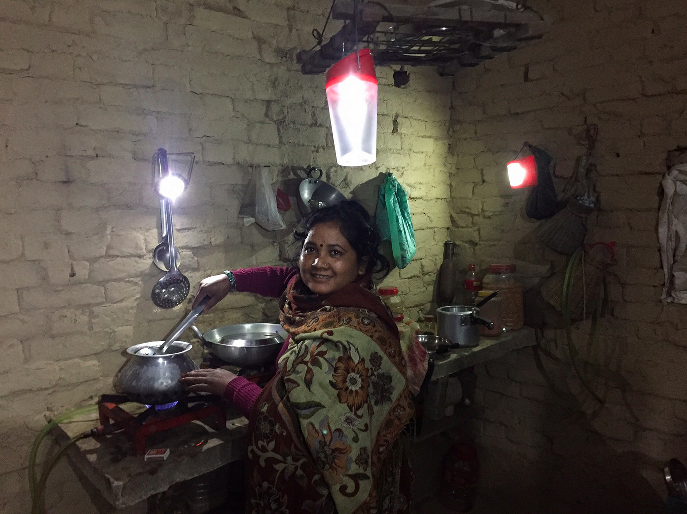 Visiting locals in Bardiya to test the solar lights which are safer and cleaner than traditional kerosene lanterns popular in many homes.