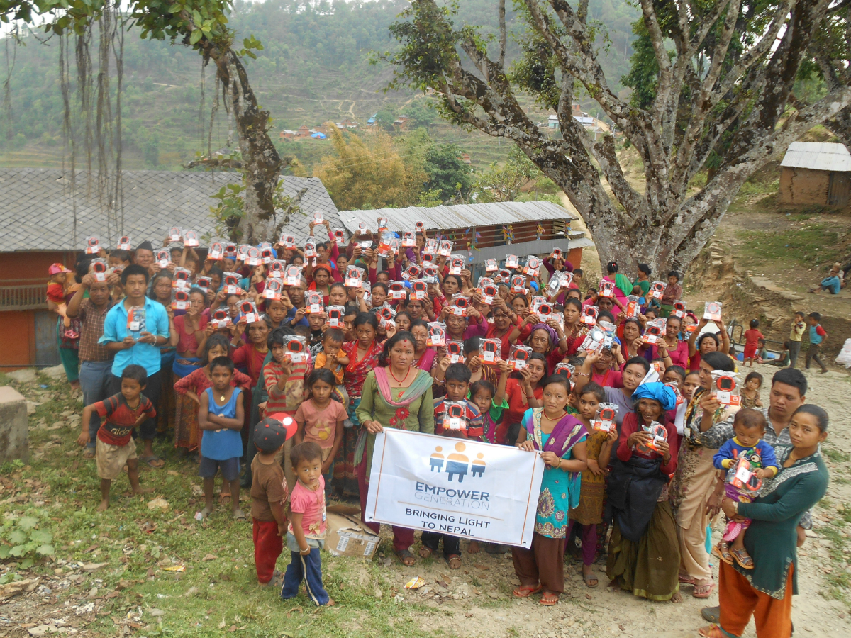 Community in Dhading with solar lights made possible to donate by Empower Generation's generous supporters.