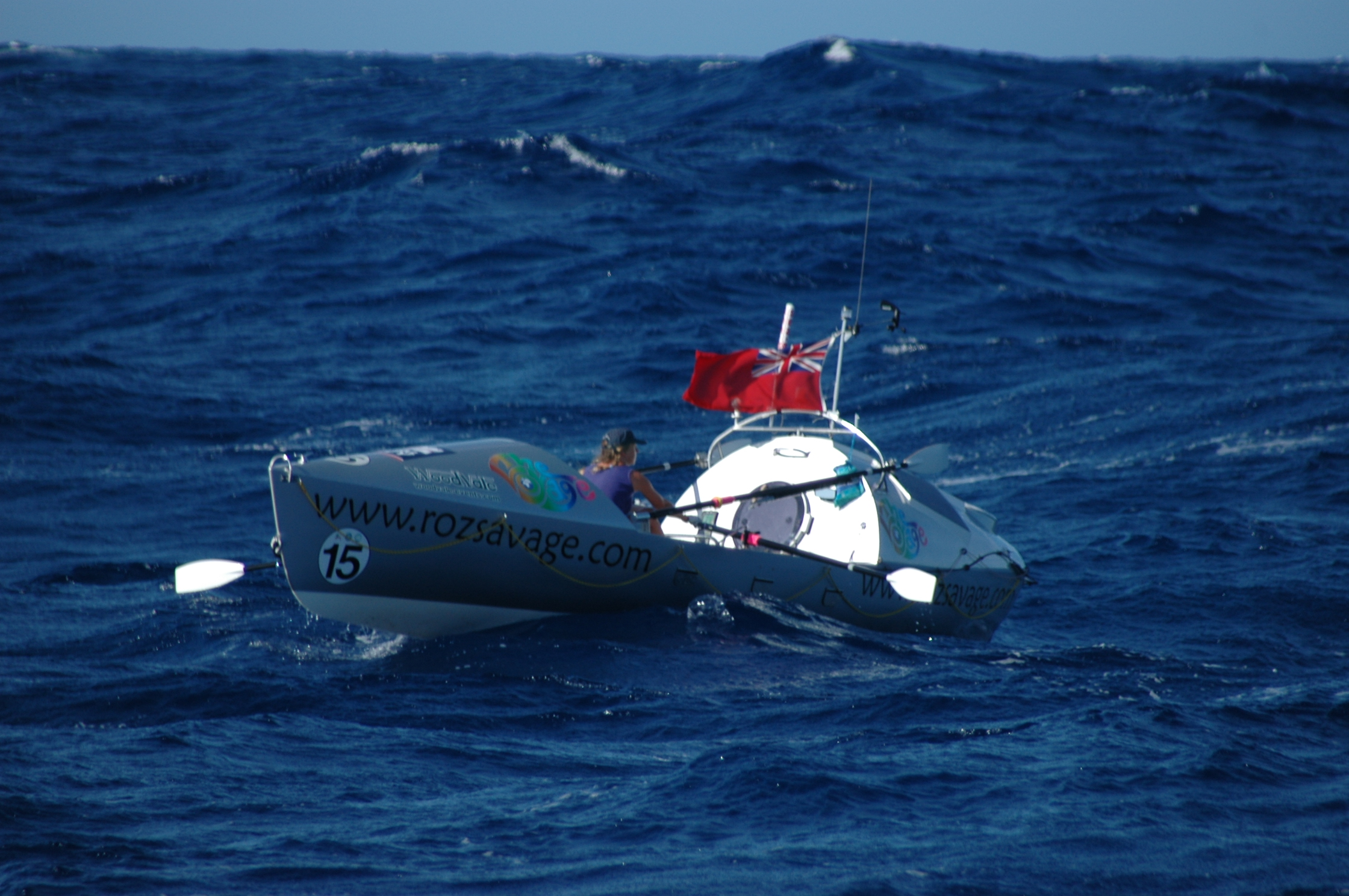 Roz Savage in her ocean rowboat, about 4 weeks after setting out from the Canary Islands on the Atlantic Rowing Race 2005.   (Photo taken from support vessel Aurora by Dan Byles)